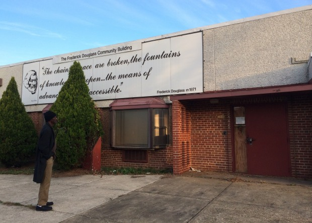 WIlliam Alston-El stands by the abandoned Frederick Douglass Community Center on Alabama Avenue SE.